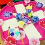 Tuff tray using flowers and paint to create art