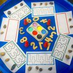 Tuff Tray counting numbers with pebbles and colours.