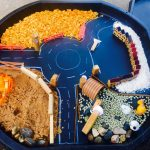 Tuff Tray with roads, farm and building and allowing sensory development.