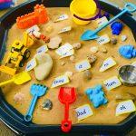 Tuff Tray using sand, utensils and phonics.